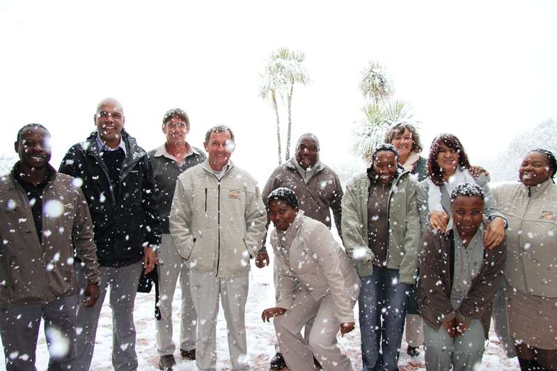 3 SANParks staff enjoying the snow at Golden Gate Highlands National Park